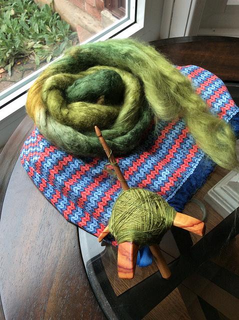 Spinning Chasing Rainbows merino/wool on Jenkins Lark Turkish spindle by irieknit