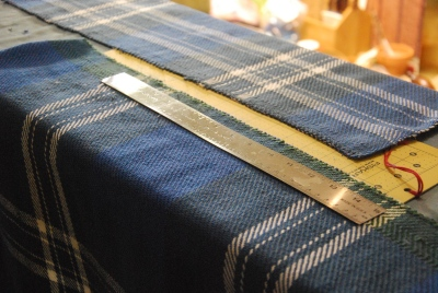 Cutting handwoven baby blanket pieces by irieknit