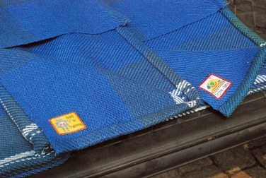 Tags and hems for handwoven cotton baby blankets by irieknit